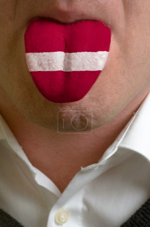 man tongue painted in latvia flag symbolizing to knowledge to sp