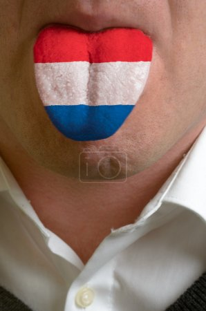 Man tongue painted in netherlands flag symbolizing to knowledge