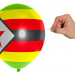 Постер, плакат: Bursting balloon colored in national flag of zimbabwe
