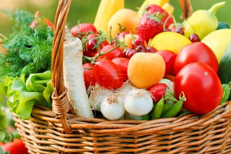 Wicker basket full of fresh fruits and vegetables