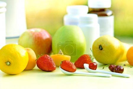 Photo for Natural vitamins - fresh organic fruits - Royalty Free Image