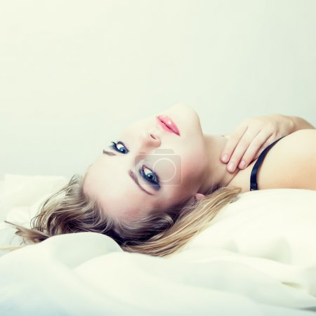 portrait of a sensual girl in bed