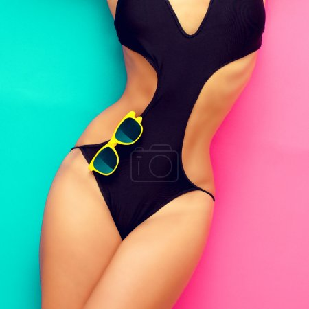 Photo for Fashion girl in a bathing suit on a pink background - Royalty Free Image