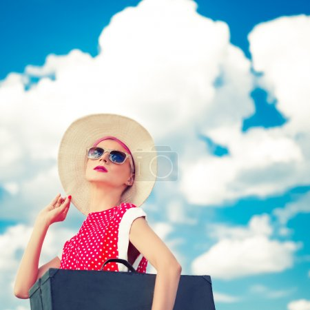 Photo for Retro girl on the blue sky background - Royalty Free Image