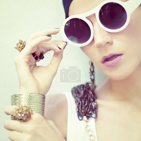 Photo for Portrait of a stylish girl in jewelry and accessories - Royalty Free Image