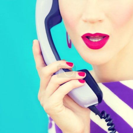 Photo for Close-up portrait of a retro girl with telephone - Royalty Free Image