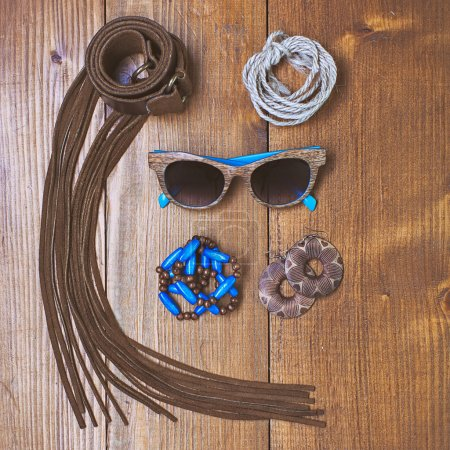 Fashion accessories on wooden background