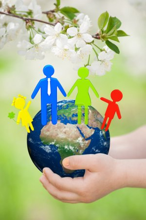 Earth with family in childrens hands