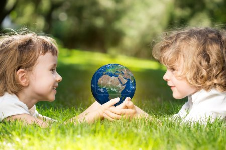 Earth in childrens hands