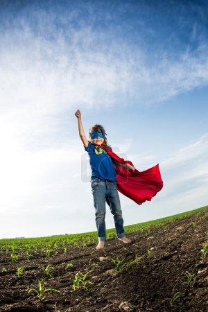 Superhero kid jumping