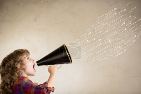 Photo for Kid shouting through vintage megaphone. Communication concept. - Royalty Free Image