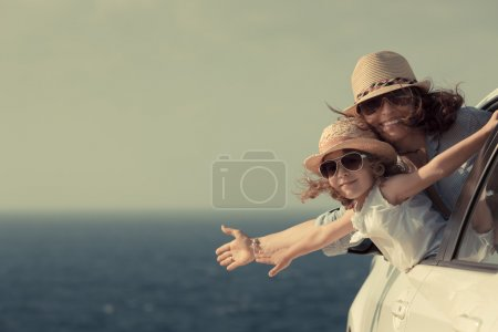 Photo for Woman and child at the beach. Summer vacations concept - Royalty Free Image