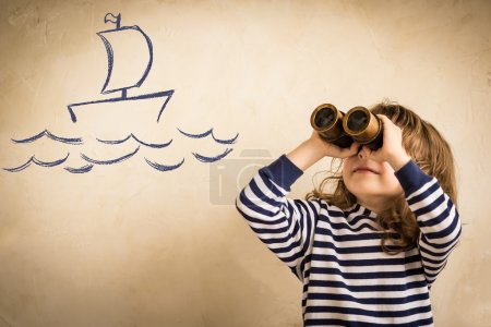 Photo for Happy sailor kid playing indoors. Smiling child look at drawing ship. Travel and adventure concept. Summer vacation - Royalty Free Image