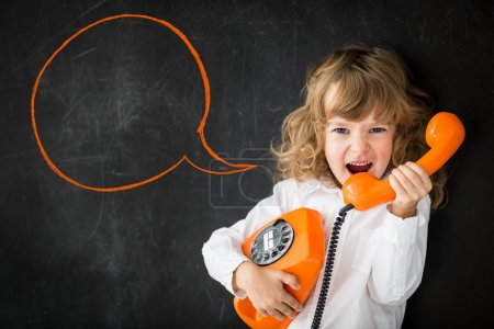 Photo for Kid shouting through vintage phone. Business communication concept - Royalty Free Image