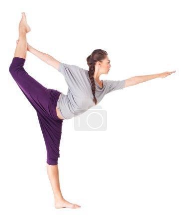 Young woman doing yoga asana Natarajasana (Lord of the Dance Pos