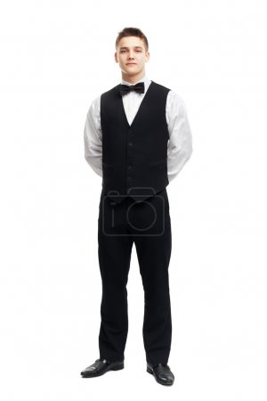 Full length portrait of young smiling waiter