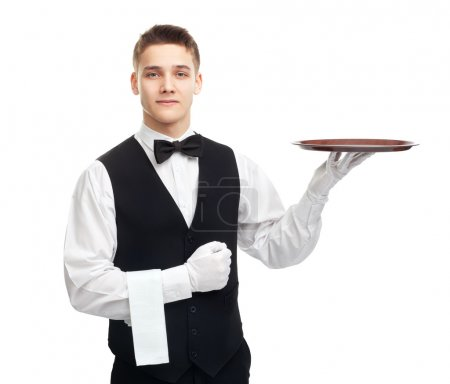 Photo for Portrait of young happy smiling waiter with empty tray isolated on white background - Royalty Free Image