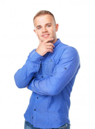 Photo for Portrait of smiling young man wearing a blue shirt isolated on white background - Royalty Free Image