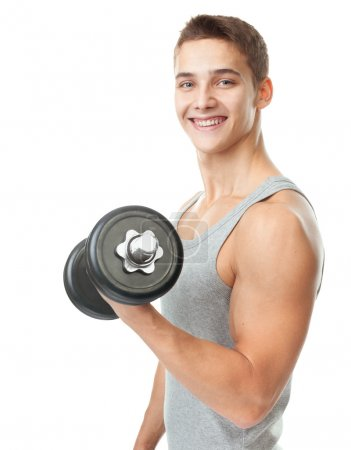 Fit man exercising with dumbbells