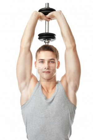 Fit man training his triceps