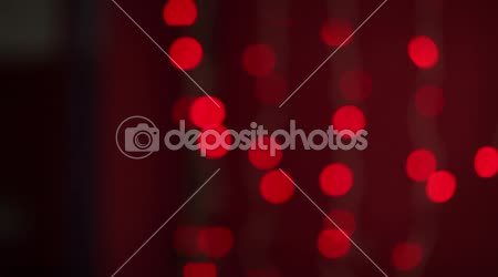 Beautiful Santa girl with Christmas lights in the background