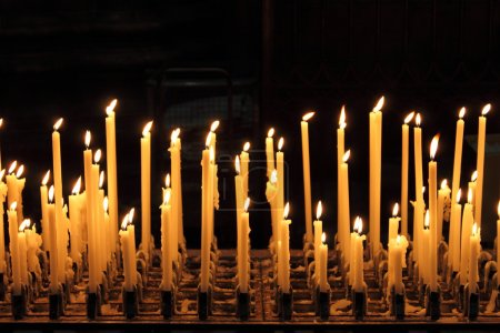 Photo for Burning candles in a church - Royalty Free Image