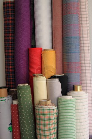 Colorful fabric rolls for sale in a haberdashery...