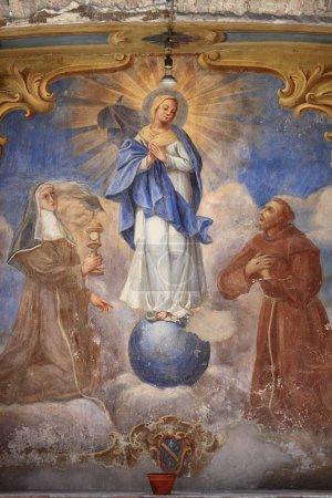 Photo pour Ancienne fresque de la Vierge avec Saint François d'assise et Sainte rita de cascia. Assisi, Italie - image libre de droit