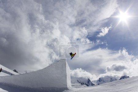 Snowboarder taking big air jump