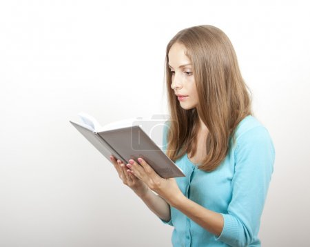 Woman reading a book, isolated