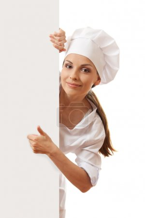 Photo for Woman cook holding paper sign, isolated on white background - Royalty Free Image