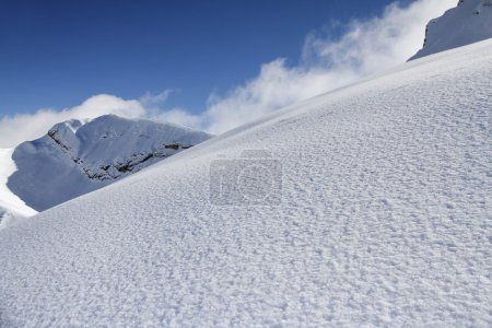 Ski slope in powder snow, mountain landscape