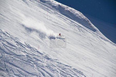 Skier going down the slope at ski resort.