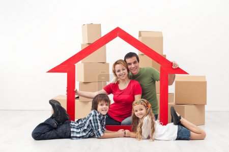 Photo for Happy family in a new home concept - sitting with cardboard boxes - Royalty Free Image