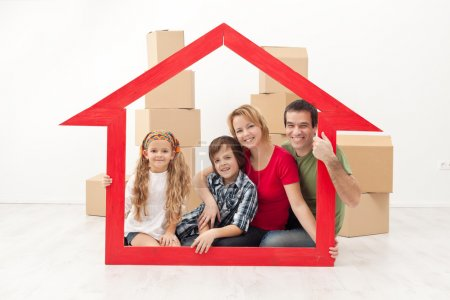 Happy family moving into a new home