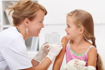 Brave little girl receiving injection