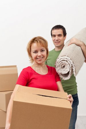 Photo for Couple moving into a new home - carrying stuff, closeup - Royalty Free Image
