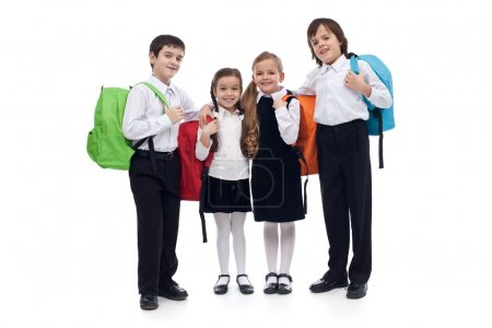 Happy elementary school kids with colorful back packs