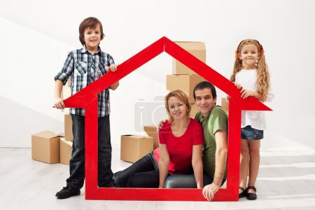 Photo for Happy family with two kids moving into their new home - sitting among cardboard boxes - Royalty Free Image