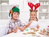 Kids decorating gingerbread christmas cookies