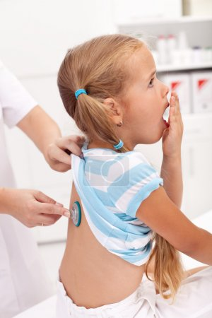Coughing little girl at the doctor