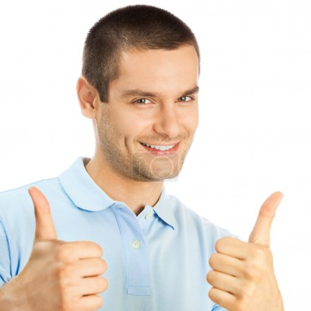 Photo for Portrait of cheerful young man showing thumbs up gesture, isolated over white background - Royalty Free Image