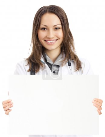 Happy doctor showing signboard, over white