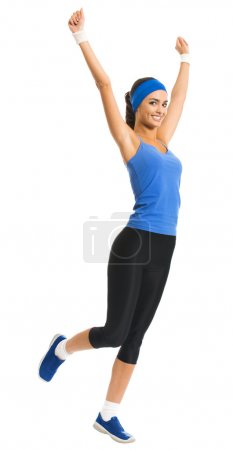 Cheerful young jumping woman, over white
