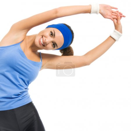 Cheerful young exercising woman, over white
