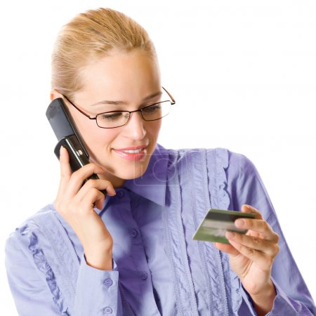 Young businesswoman with plastic card, on cellphone, isolated on