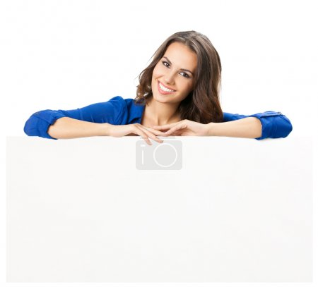 Photo for Happy smiling beautiful young woman showing blank signboard or copyspace, isolated over white background - Royalty Free Image