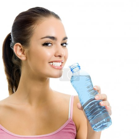 Young woman drinking water, isolated over white