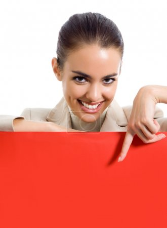 Happy young business woman showing blank red signboard, isolated over white background