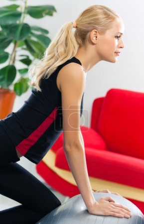 Woman with fitball at home
